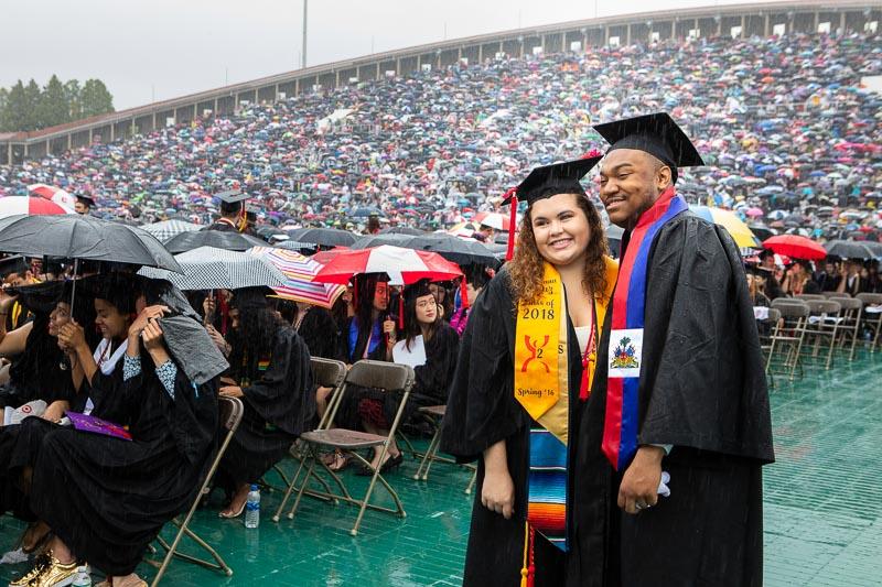Photo of two graduates in the stadium
