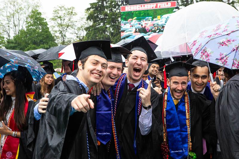 Photo of three graduates smiling