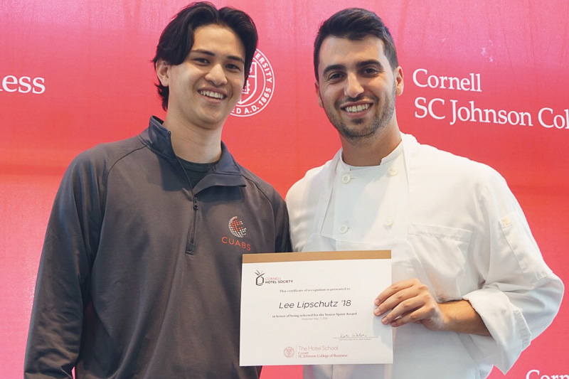 Photo of Michael and Lee holding a certificate