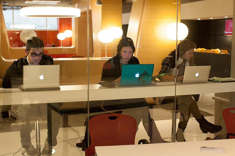 Photo of students studying by themselves with laptops