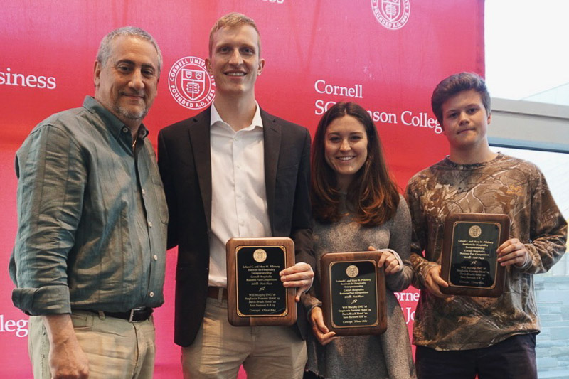 Photo of Neil and students holding plaques