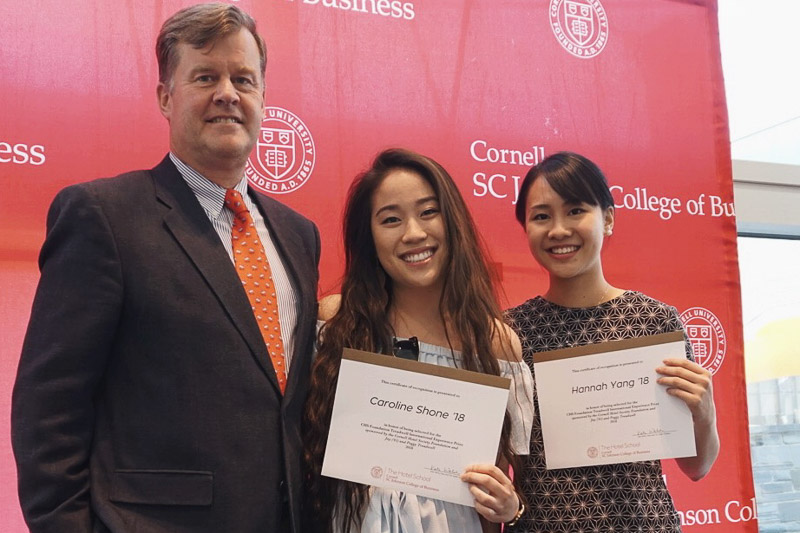 Photo of Phil with Caroline and Hannah holding certificates