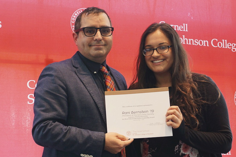 Photo of Rabinder and Rani holding a certificate
