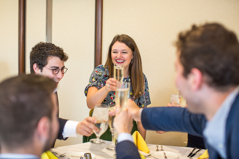 Photo of Kayti Stanley holding a glass for a toast