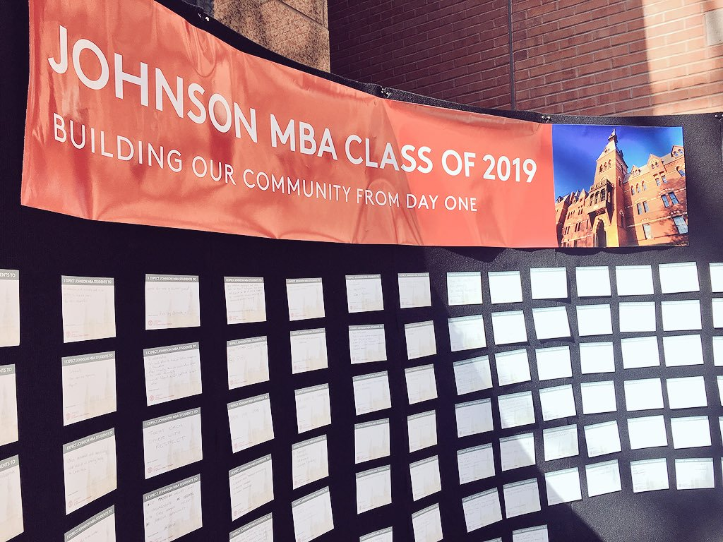 """Large bulletin board that says """"Building our community from day 1"""""""