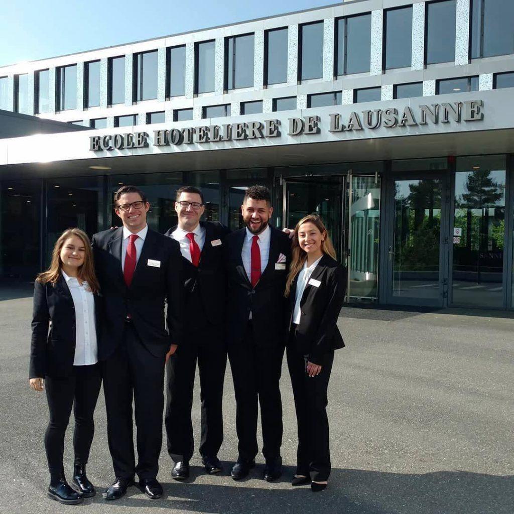 SHA students standing outside Ecole Hoteliere De Lausanne