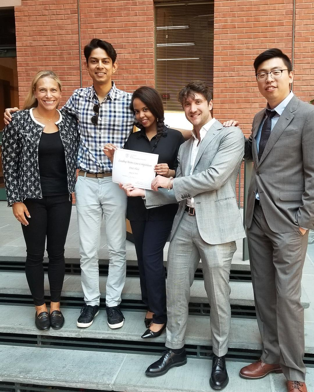Five students pose with their certificate
