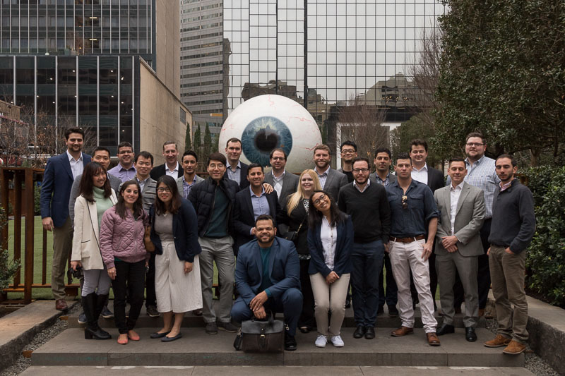 Photo of the group standing outside a building with a large eyeball statue