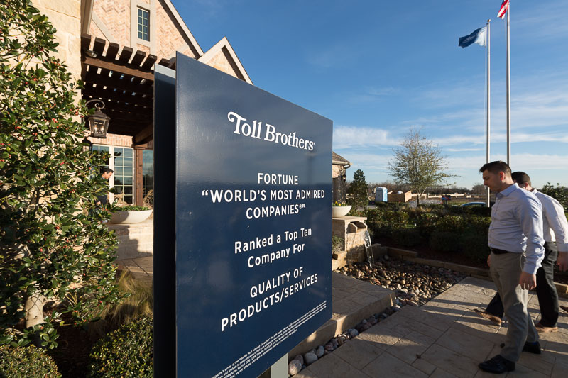 """Photo of people entering a building that says Toll Brothers, Fortune 'World's most admired companies"""""""