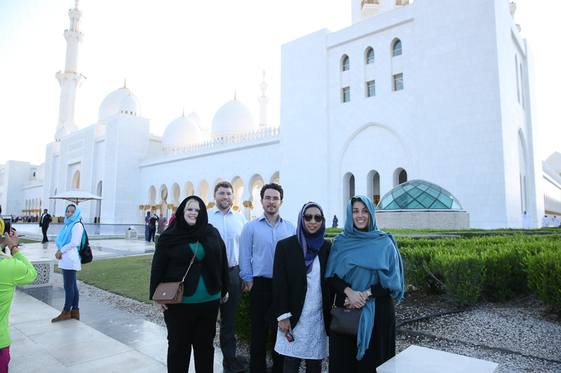 Photo of five people standing outside of a building in Dubai