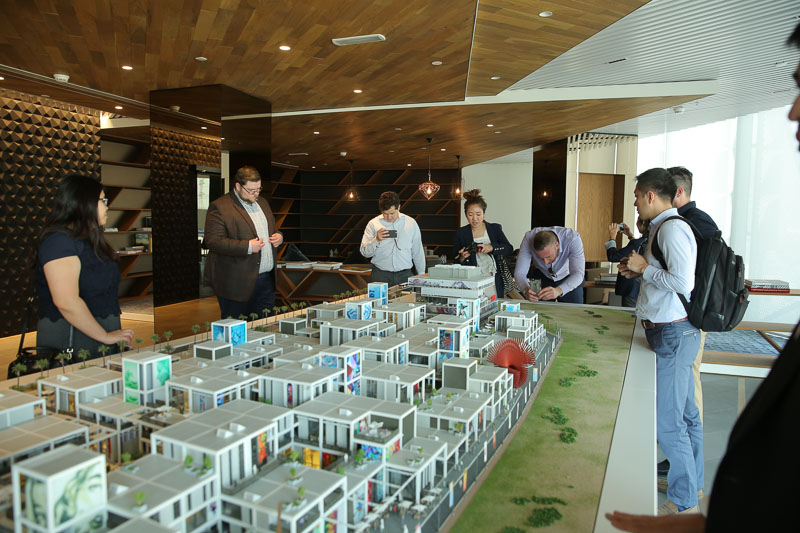 Photo of students looking at a large scale model of a city