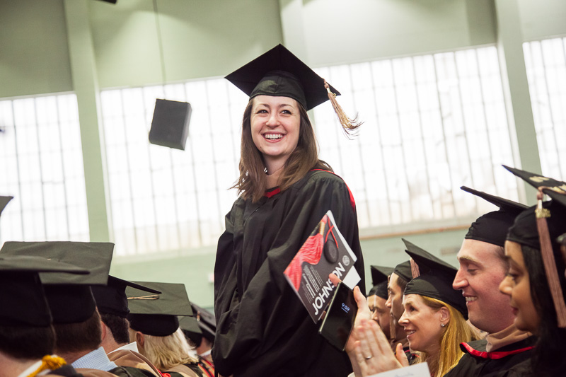 Photo of a graduate standing
