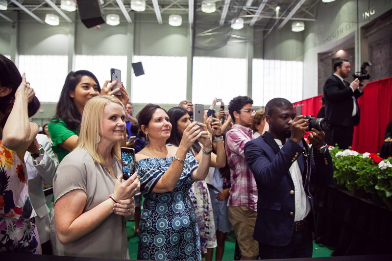 Photo of audience members taking pictures