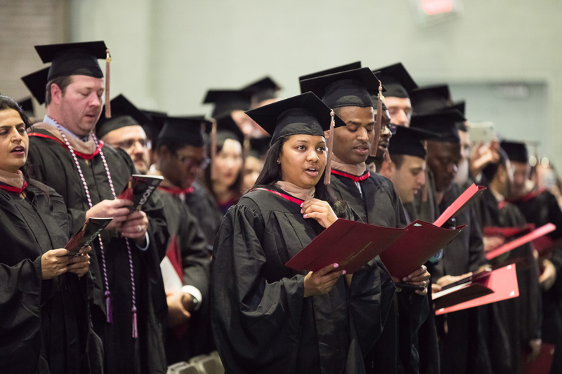 Photo of singing graduates