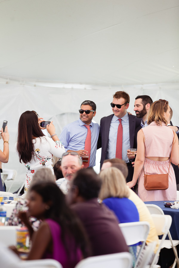 Photo of graduates wearing sunglasses