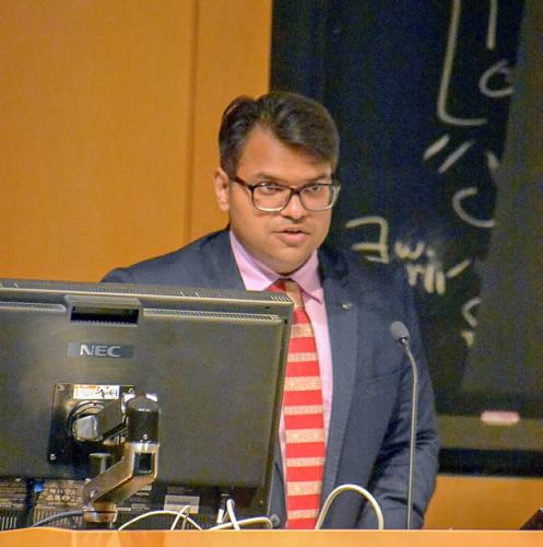 Photo of Gautam at the podium