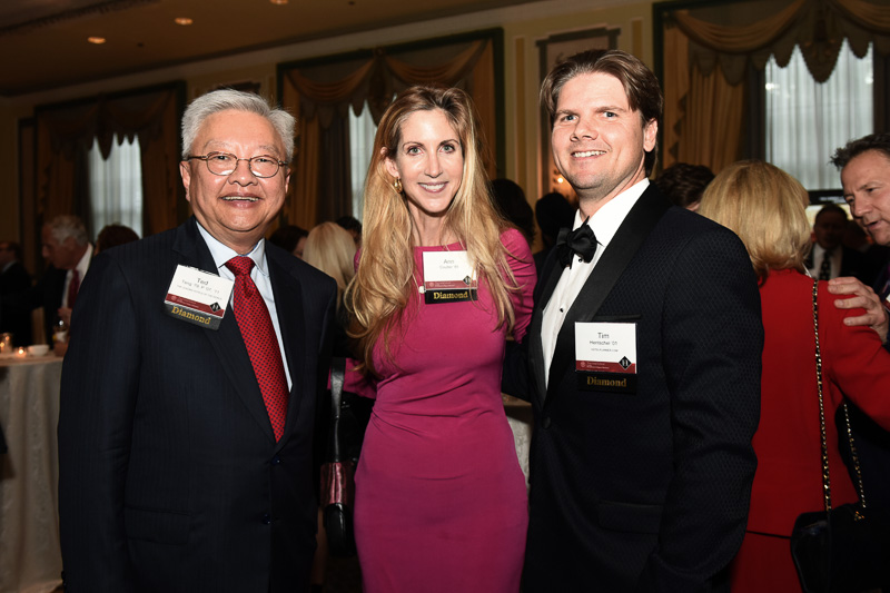 Photo of three people in the banquet hall