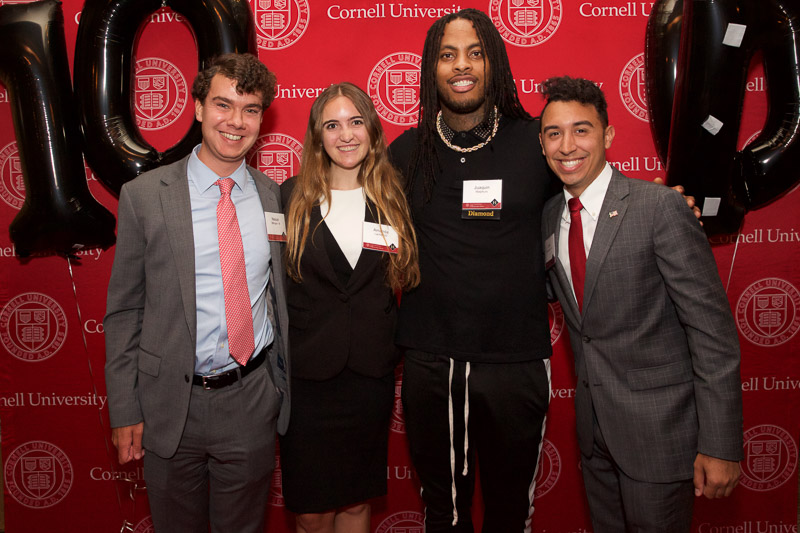 Photo of four people in front of the SHA step-and-repeat on the red carpet