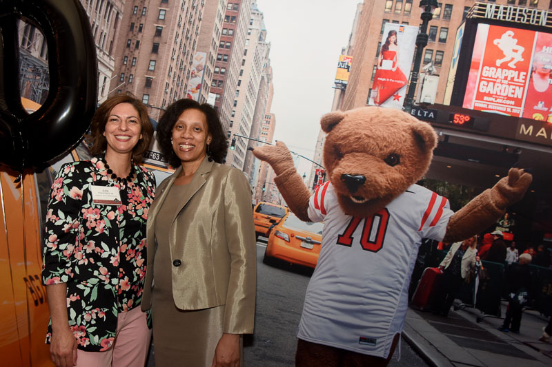 Photo of two women and touchdown the bear on a NYC street