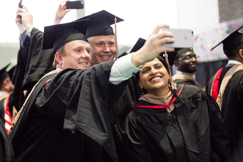 Photo of graduates taking selfies
