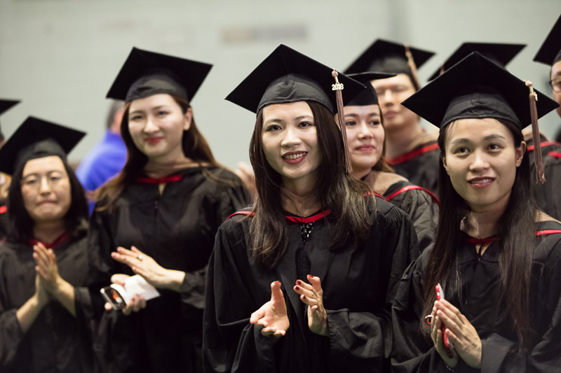 Photo of graduates clapping