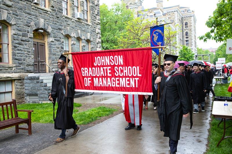 Photo of graduate banner bearers