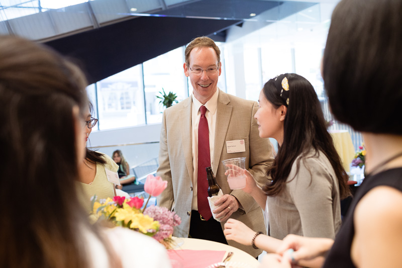 Photo of Dean Nelson talking to attendees