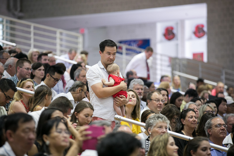 Photo of an audience member holding a baby