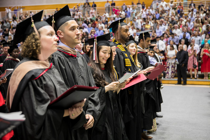 Photo of standing, singing graduates