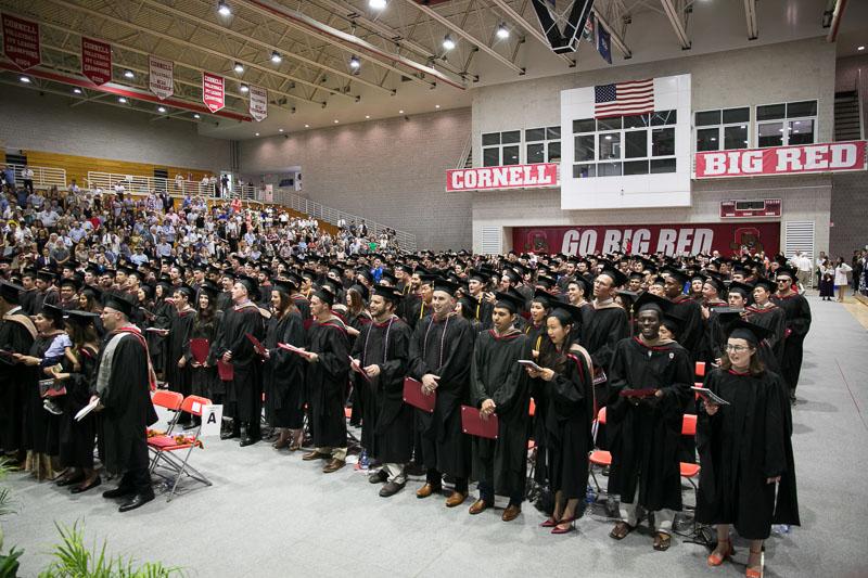 Photo of standing graduates