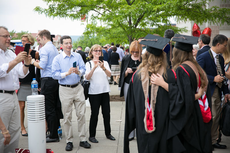 Photos of graduates having their picture taken outside