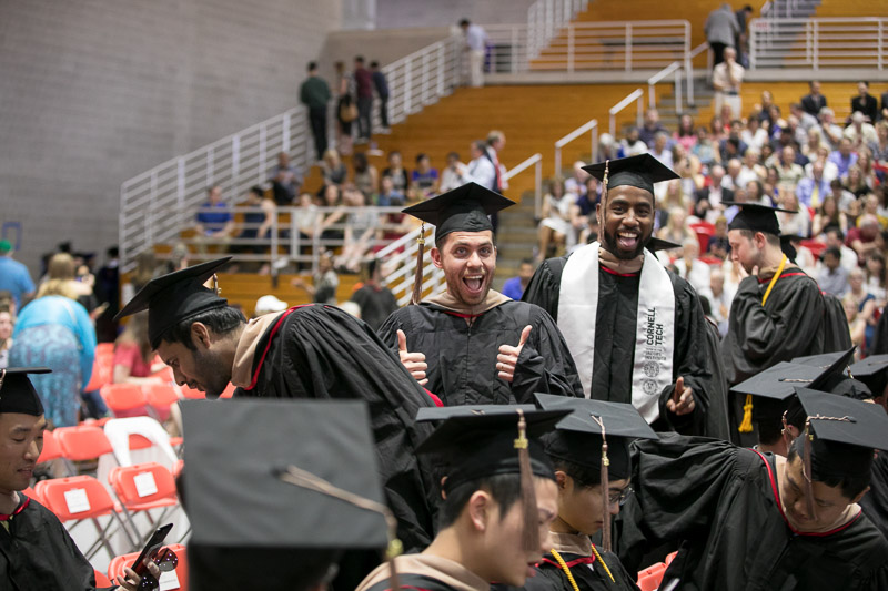 Photo of a graduate giving a thumbs up