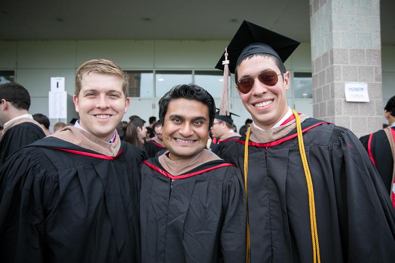 Photo of three male graduates