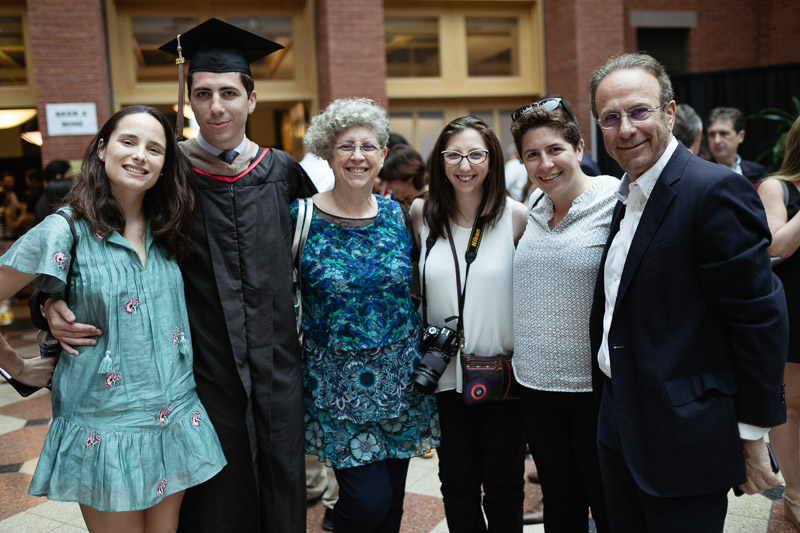 Photo of a graduate and his family