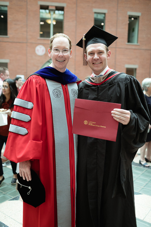 Photo of Dean Nelson and a graduate
