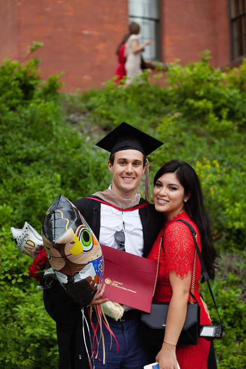 Photo of a male graduate and a woman
