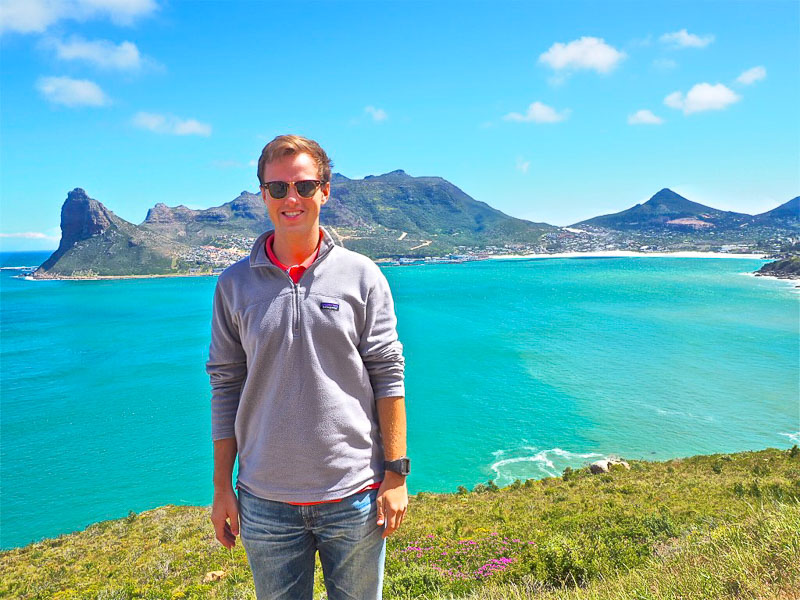 Photo of Robert with bright blue water in the background