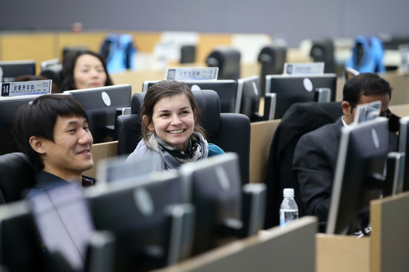 Photo of a woman smiling in a computer lab