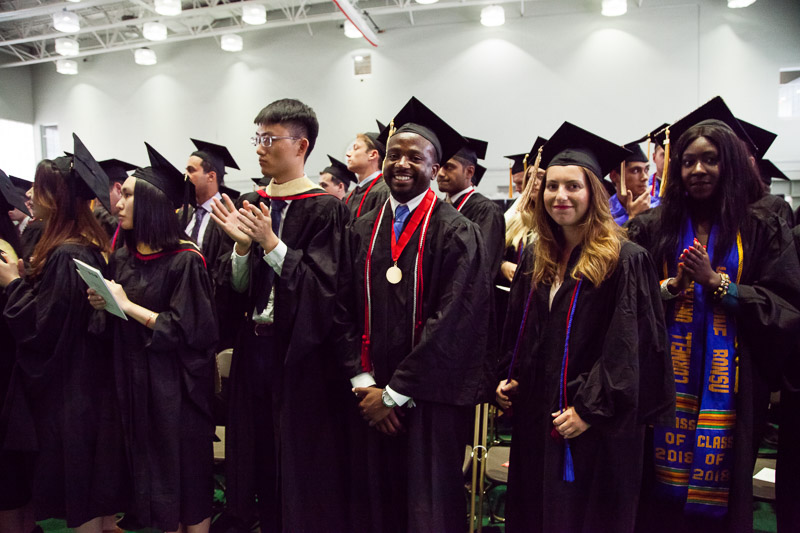 Photo of graduates standing up together