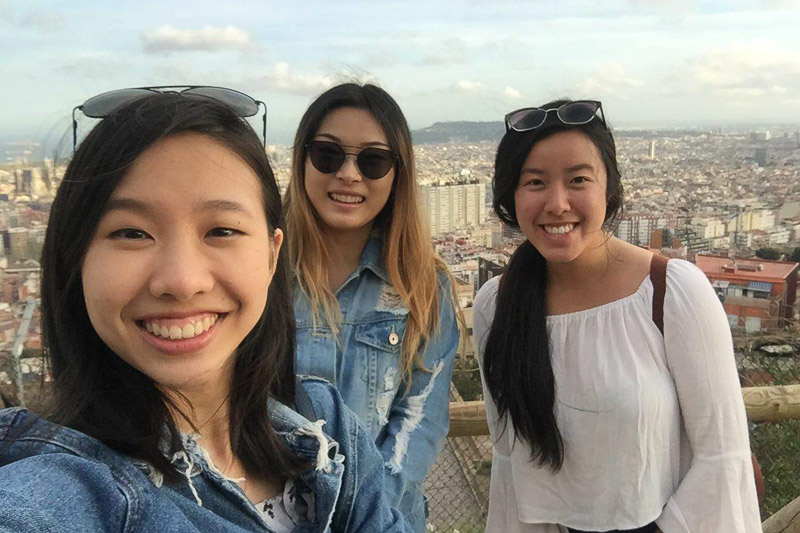 Photo of Tasha and two other women overlooking an historic city