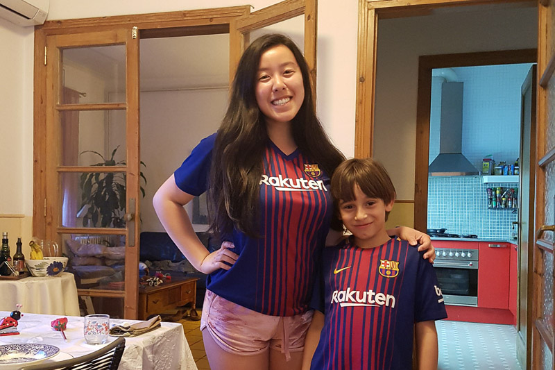 Photo of Tasha and her host brother wearing soccer jerseys