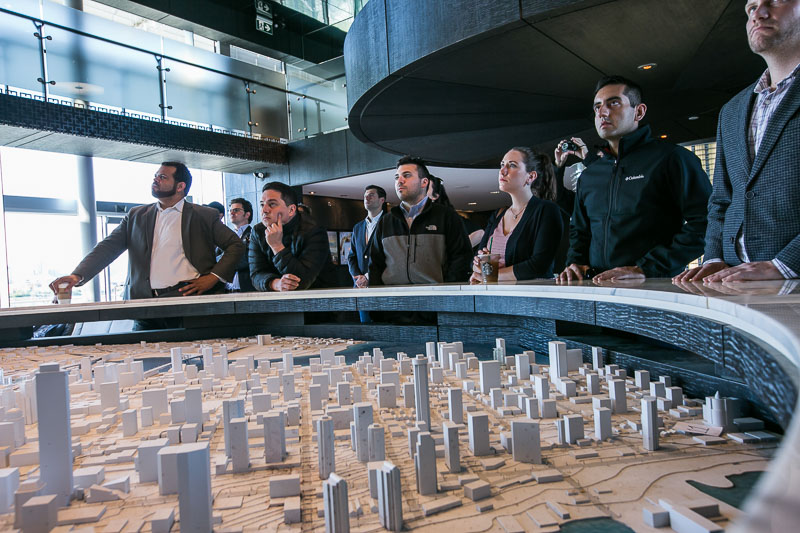Photo of students looking at a scale model of a city