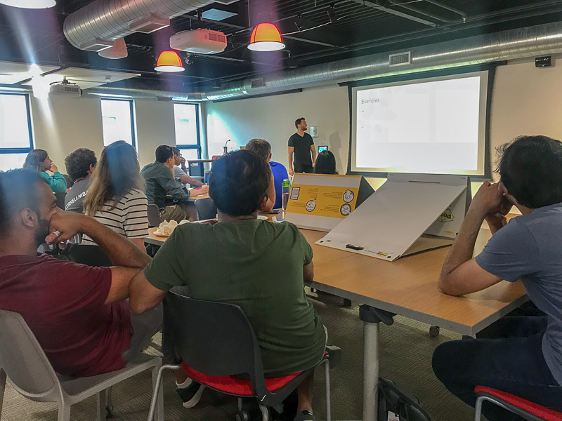 Photo of students listening to a presentation