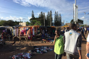 Photo of the streets of Kenya, lots of hanging clothes