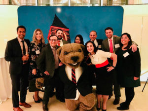 Photo of a group of people with Touchdown the bear at a reception