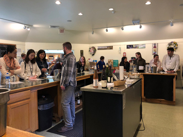A group of MMH students enjoy an educational wine tasting session