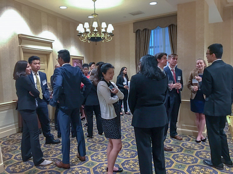 Photo of people mingling in a ballroom