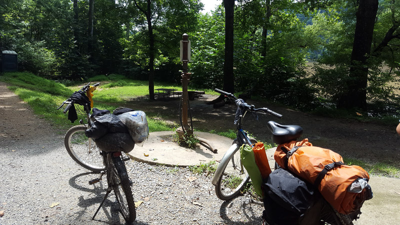 Two bikes standing on a path