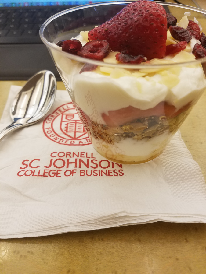 Yogurt cup on a Cornell SC Johnson College of Business napkin