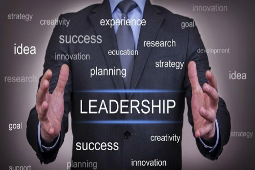 man standing behind words leadership success etc.